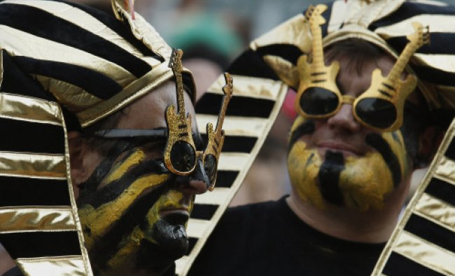 Rugby fans watch a preliminary match during the first day of the Hong Kong Sevens rugby tournament..