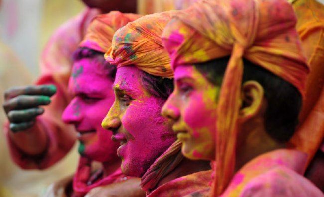 Devotees participate in rituals for the Lathmar Holi festival at the Nandji Temple in Nandgaon on...