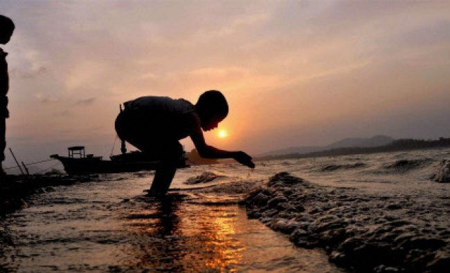A boy at the bank of river Brahmaputra in Guwahati on Friday...