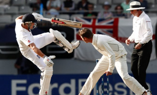 Compton loses his balance after being hit by the ball watched by Martin...