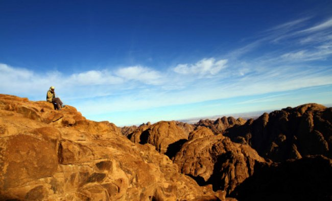 An Egyptian guide takes a break after climbing to the summit of Mount St. Catherine in south Sinai..