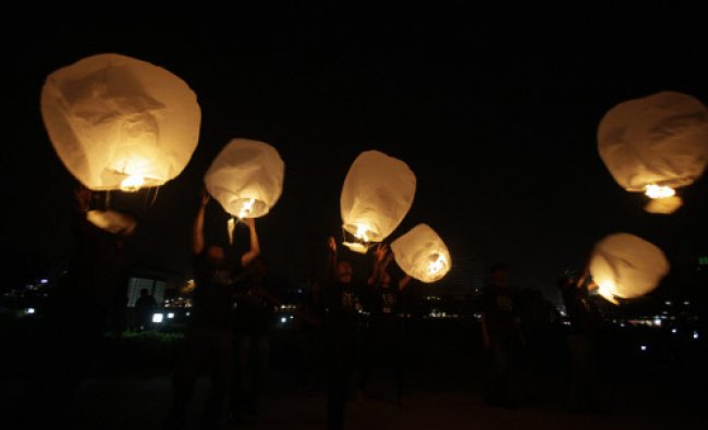 Volunteers flay paper lanterns as they take part in the global Earth Hour initiative by World...