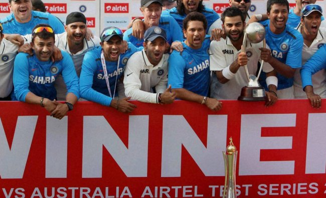 Indian cricketers pose with trophy after winning the fouth test against Australia ...