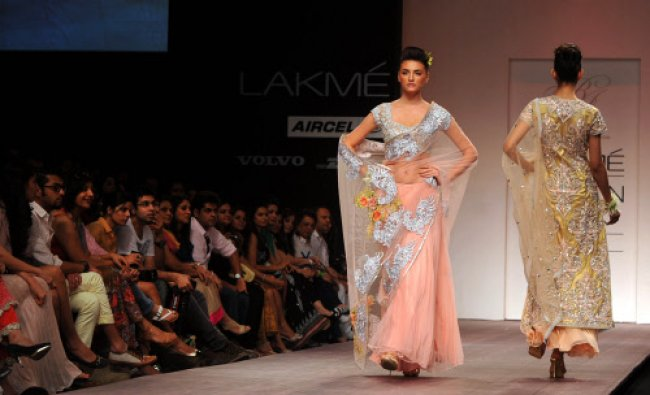Models showcase a creation by designer Bhairavi Jaikishan during a fashion show on LFW...