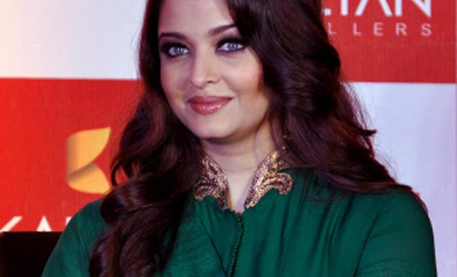 Actress Aishwarya Rai Bachchan poses during the launch of new branches of Kalyan Jewellers....