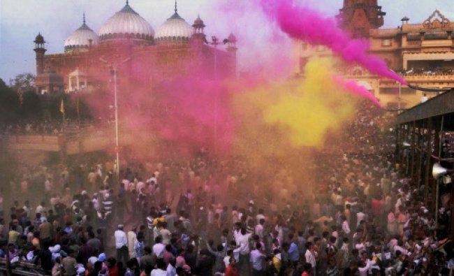 Devotees particapting in Lath mar Holi celebration at Sri Krishna Janamsthan temple in Mathura...