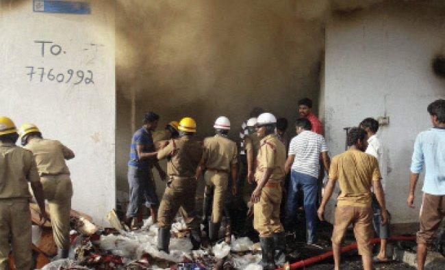 Fire at a factory at Magadi Road in Bengaluru on Monday. ..