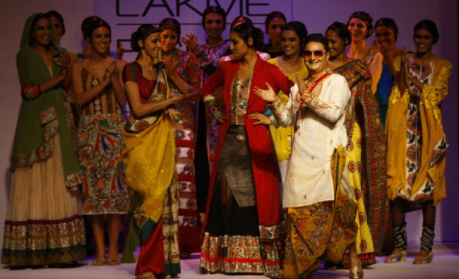 Bollywood star Vinay Pathak, foreground right, joins models in displaying a creation by Agnimitra...