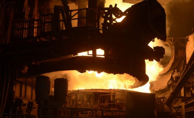 The top of a steel pan is pictured beside a furnace at the plant of German steel company Arcelor...