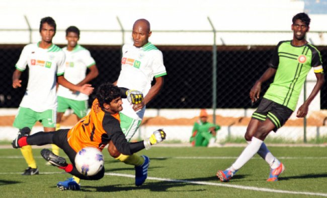 Stephen of Southern United FCI hits the kick as Akhil Soman Goal keeper of team Eagles FC trying...