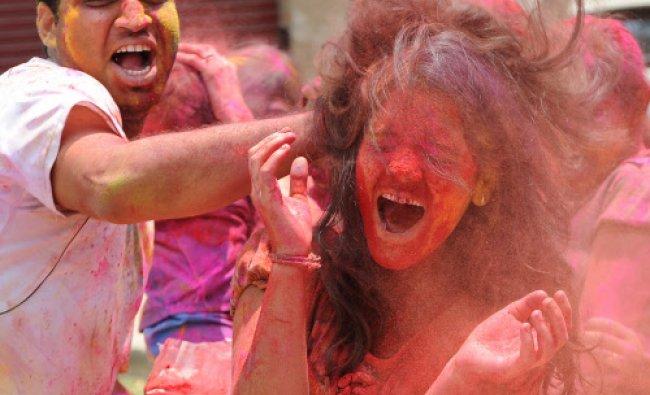 Youths celebrating festival of colour Holi at Ambedkar Layout of Vijayanagar...