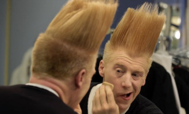 This photo shows performer Bello Nock appling make-up in his dressing room preparing for Bello Mania