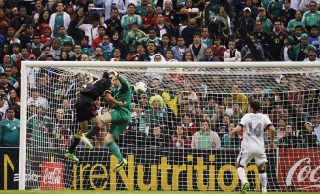 Mexico\'s Jesus Zavala fights for the ball with goalkeeper Brad Guzan of the U.S. during their ...