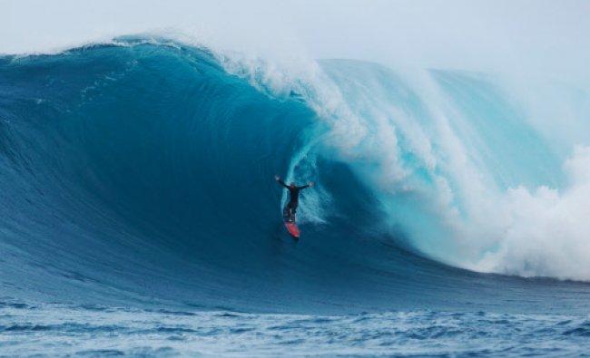 In this Oct. 9, 2012, photo provided by BillabongXXL.com, Big Island pro surfer Shane Dorian rides..