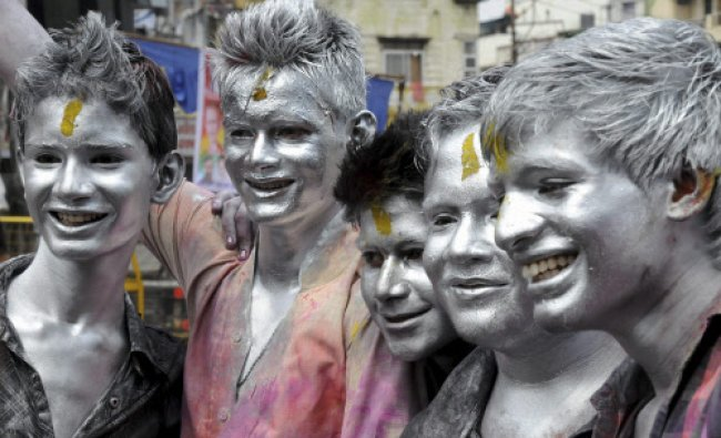 Youths celebrate Holi festival in Bhopal on Wednesday...