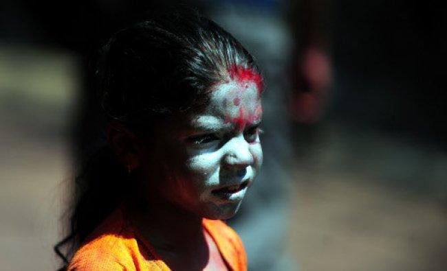 A reveller looks on during Holi festival celebrations in Allahabad...