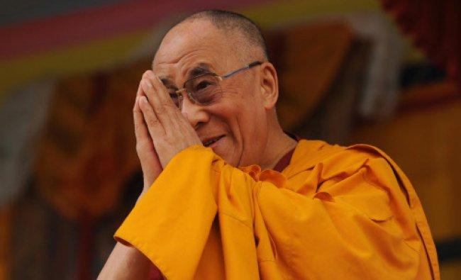 Spiritual leader the Dalai Lama greets his followers at the Buddhist cultural school in Salugara...