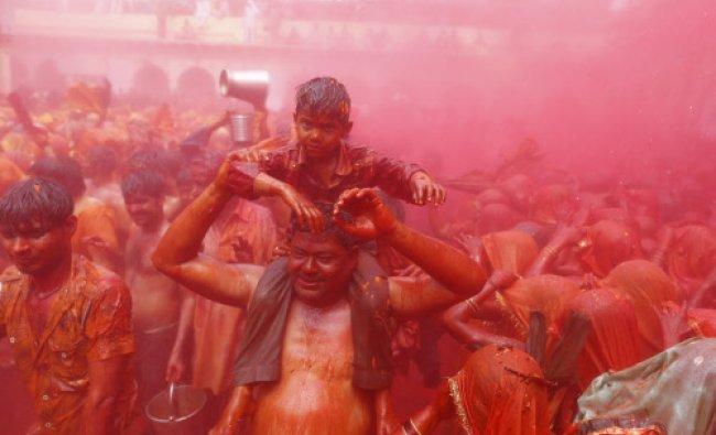 Men and women take part in \'Huranga\' at Dauji temple, near Mathura...
