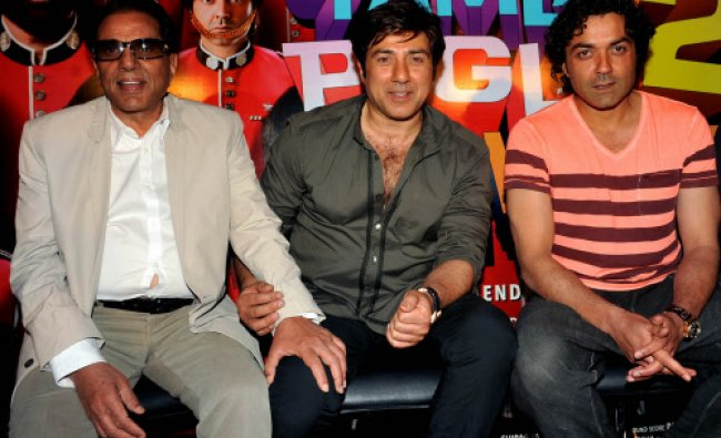 Actors Dharmendra (L), Sunny Deol (C) and Bobby Deol (R) look on during the launch...