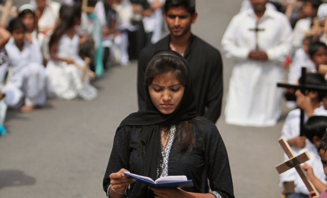 Christian devotees pray on Good Friday in Jammu, India...