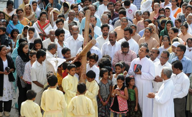People from Christian community are seen participating in the Good Friday programme in Gulbarga...