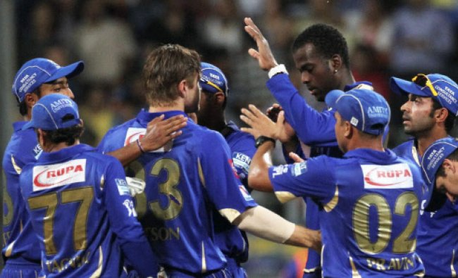 Rajasthan Royals cricketers celebrate the dismissal of wicket of Mumbai Indians batsman Maxwell...