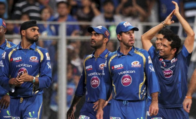 Mumbai Indians celebrate their victory with a victory lap around the stadium after an IPL 6 match.