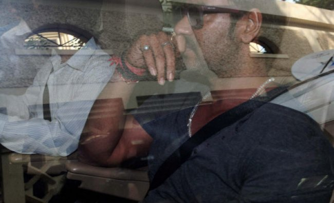 Bollywood actor Ajay Devgn leaves after visiting actor Sanjay Dutt at his residence in Mumbai...