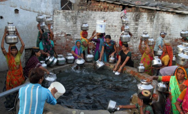 People ollect water from a bore well tank at Juval village, about 40 kilometers from Ahmadabad...