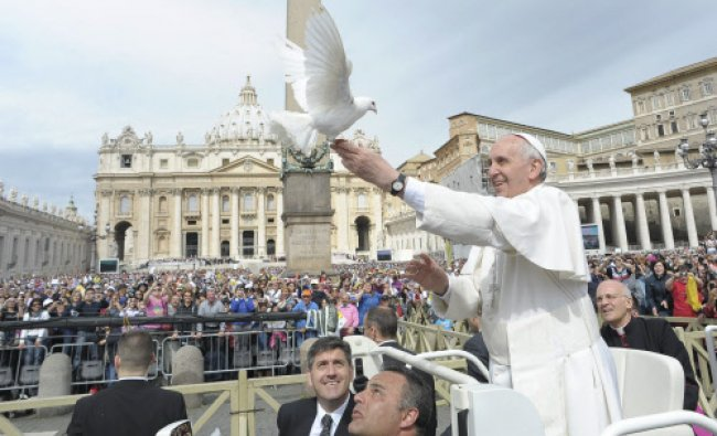 Pope Francis holds a dove before his Wednesday general audience at Saint Peter\'s Square at the...