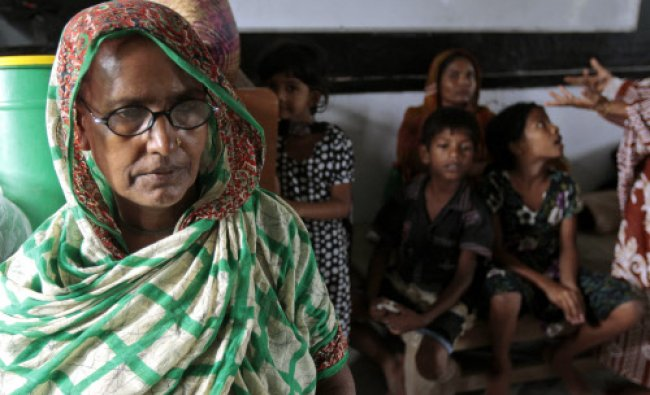 Bangladeshis rest at a cyclone shelter center ahead before Cyclone Mahasen made landfall in...