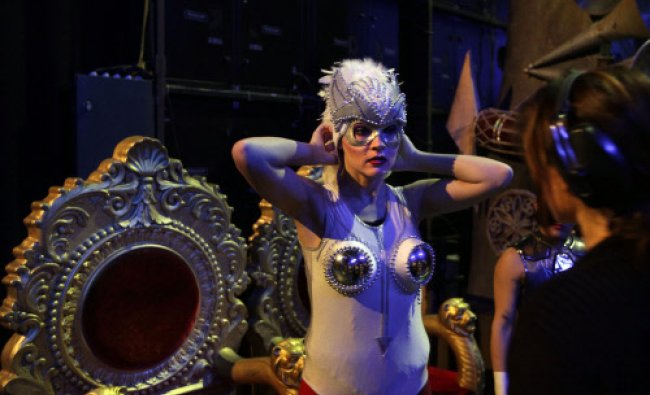 An artist prepares Backstage before for the media preview of the French Cirque Spectacle \'Mana\'...