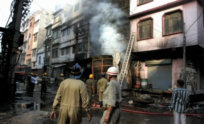 New Delhi: Fire fighters dousing a fire that broke out in a toy factory in New Delhi on Saturday...