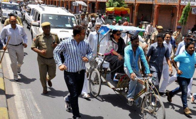 Jaipur: Rajasthan BJP President Vasundhra Raje arrives in a rickshaw to address a protest...
