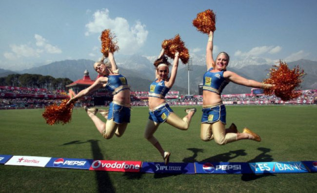 Dharamshala: Cheerleaders performing during the IPL 6 match between Kings XI Punjab and Mumbai...
