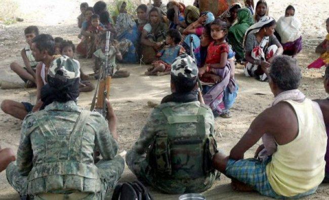 Latehar: A Naxal group\'s Jan Adalat (people\'s court) in a Maoist-hit village in Latehar on...
