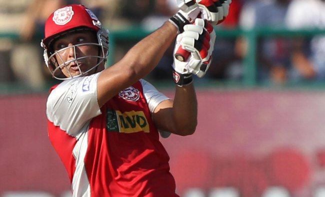 Kings XI Punjab\'s Azhar Mahmood plays a shot against Mumbai Indians...
