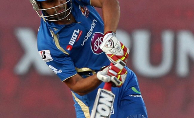 Mumbai Indians\' Rohit Sharma plays a shot against Kings XI Punjab...