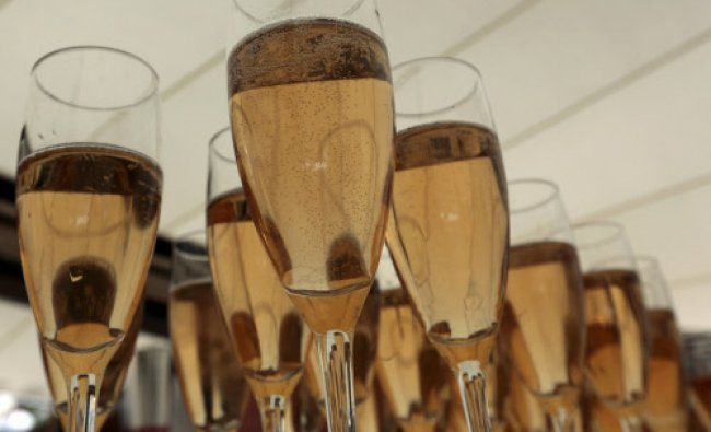 Champagne glasses are pictured at a private beach bar along La Croisette during the 66th Cannes...