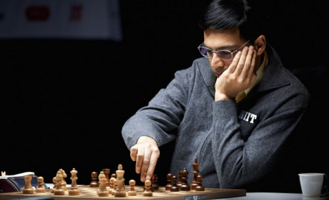 World chess champion Viswananthan Anand of India makes a move during the last round of the Norway...