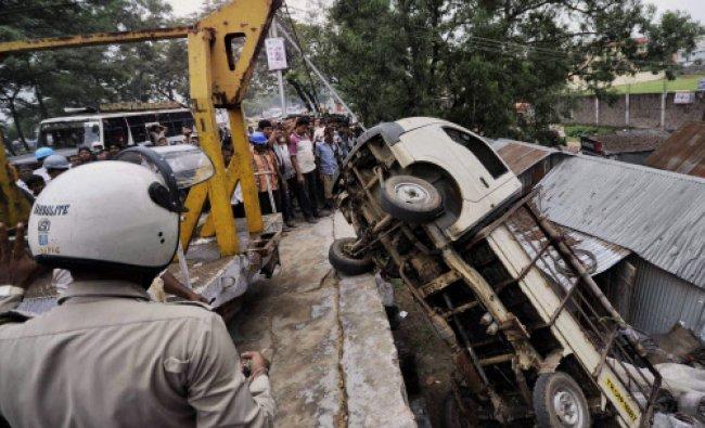 Agartala: Restoration work in progress after a loaded truck overturned in Agartala...