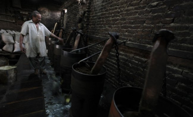 Saddiq, 48, works in a Taramira oil processing factory in Rawalpindi May 20, 2013. Taramira oil...