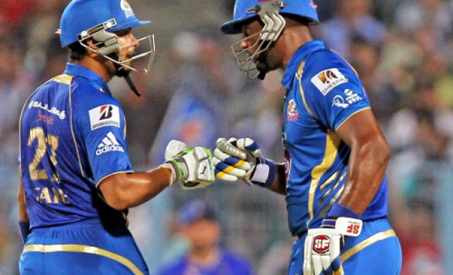 Mumbai Indian batsman Dwayne Smith and Aditya Tare greets each other to built up their ...