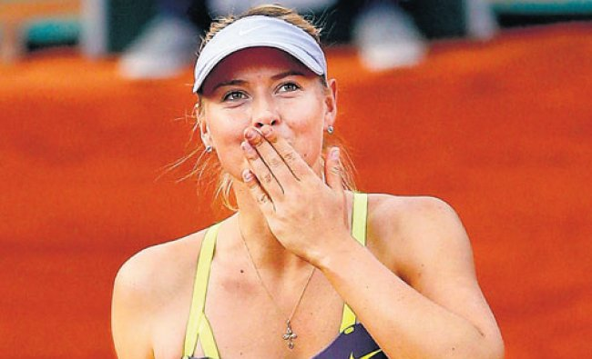 Russia\'s Maria Sharapova serves against Su-Wei Hsieh of Taipei in their first round match of the...