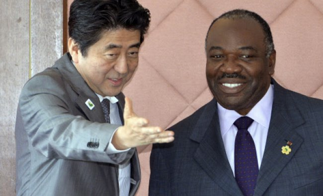 President of Gabon Ali Bongo Ondimba, right, is greeted by Japanese Prime Minister Shinzo Abe ...