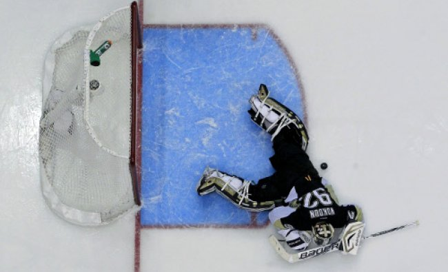 Pittsburgh Penguins goalie Tomas Vokoun (92) lies in the goal crease after allowing a goal...