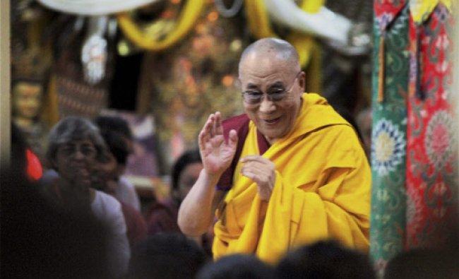 Tibetan Spiritual Leader the Dalai Lama gestures to the followers as he give religious teaching...