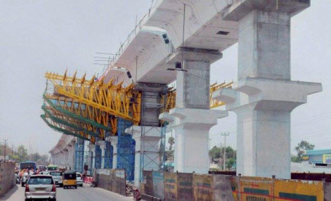 Hyderabad: Construction work of the Hyderabad Metro Rail underway in Hyderabad, on Sunday...