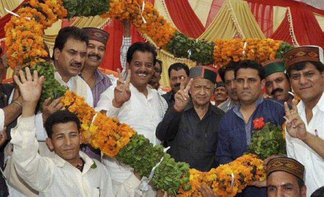 Kullu: Himachal Pradesh Chief Minister Virbhadra Singh being welcomed with a garland in Kullu on...