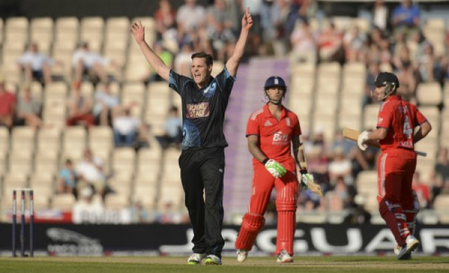New Zealand\'s Mitchell McClenaghan celebrates as his team defeated England by 86 runs...
